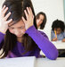 young-girl-frustrated-school-desk