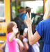 mother-waving-goodbye-daughter-school-bus