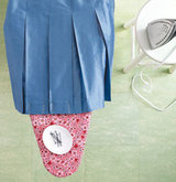 bobby-pins-bolding-pleats-place-while-ironing